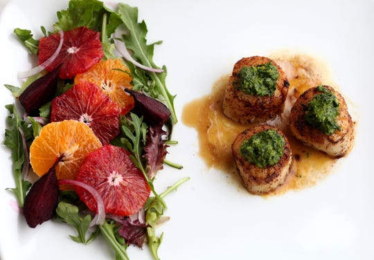Sea Scallops on Cara Cara sauce and cilantro pesto. Clementine and Blood orange citrus salad.