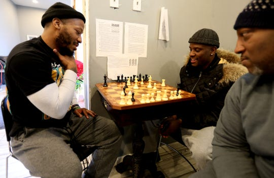 (L to R) Lloyd Harrison contemplates his next chess move on his brother and boxer Tony Harrison as Basim El-Amin looks on at SuperBad Fitness on Puritan Avenue in Detroit on Friday, January, 11, 2019. Lloyd is not only Tony's brother but also his trainer and the two play chess often as they say it helps with the mental game of boxing.