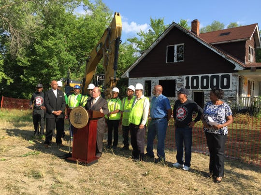 Mayor Mike Duggan talks to the news conference on Tuesday, July 19, 2016, marking the 10,000th home of Detroit home from his office.