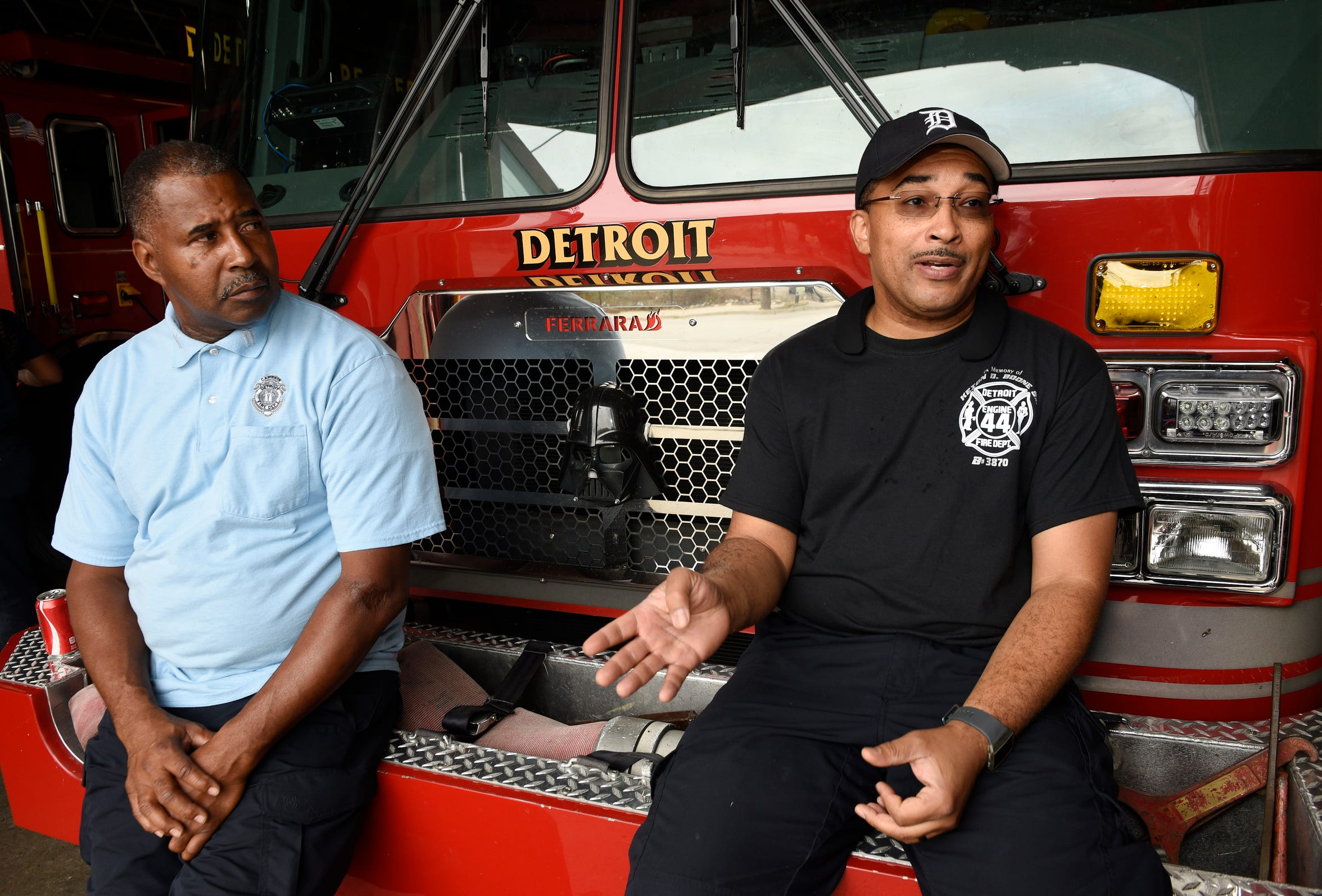 Fire Capt. Dexter Dixon, left, and firefighter Darrell Tucker talk about being on the frontlines of the opioid crisis in Detroit.