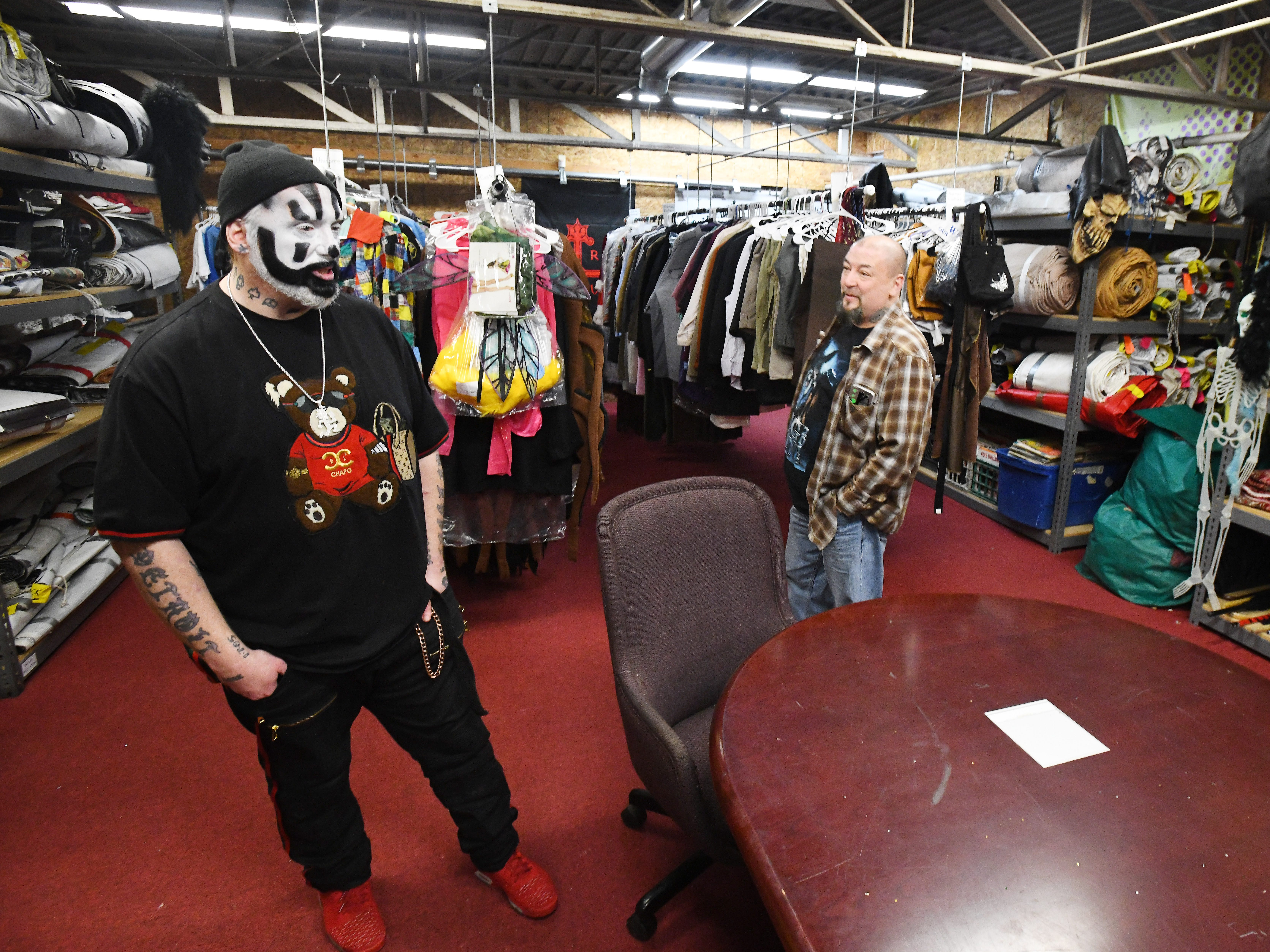 "Violent J, aka Joseph Bruce of Insane Clown Posse, with Rudy ""Rude Boy"" Hill shows off costume storage where outfits and various paraphernalia are stored from their elaborate shows and tours."