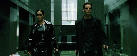 "Carrie-Anne Moss and Keanu Reeves in ""The Matrix."""