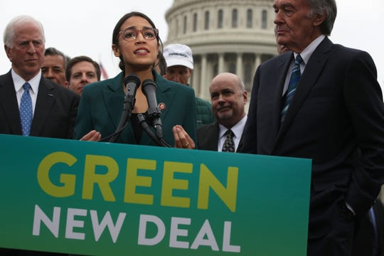 U.S. Rep. Alexandria Ocasio-Cortez (D-NY) speaks as Sen. Ed Markey (D-MA) (R) and other Congressional Democrats listen during a news conference in front of the U.S. Capitol February 7, 2019 in Washington, DC. Sen. Markey and Rep. Ocasio-Cortez held a news conference to unveil their Green New Deal resolution.