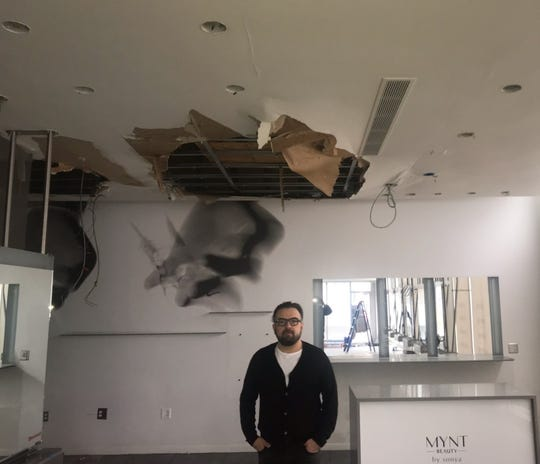 George Nikollaj, owner of 6 Salon, is dealing with a collapsed ceiling.