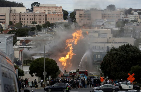 San Francisco firefighters battle a fire on Geary Boulevard in San Francisco, Wednesday, Feb. 6, 2019.