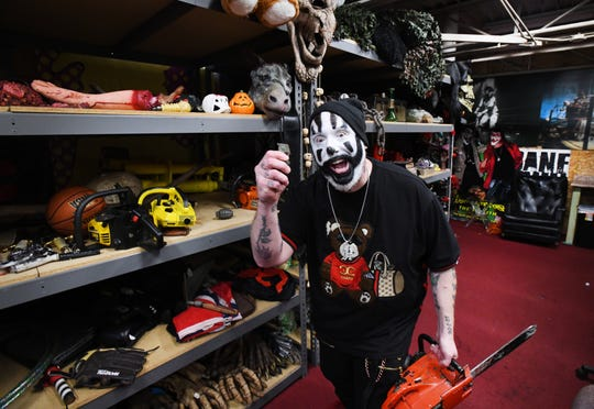 Violent J, aka Joseph Bruce of Insane Clown Posse shows off costume storage where outfits and various paraphernalia, including a hand grenade prop, is stored from their elaborate shows and tours. 