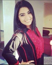 Najilaa Karim Musarsa, wearing her traditional Palestinian thobe, was among those raided and detained.