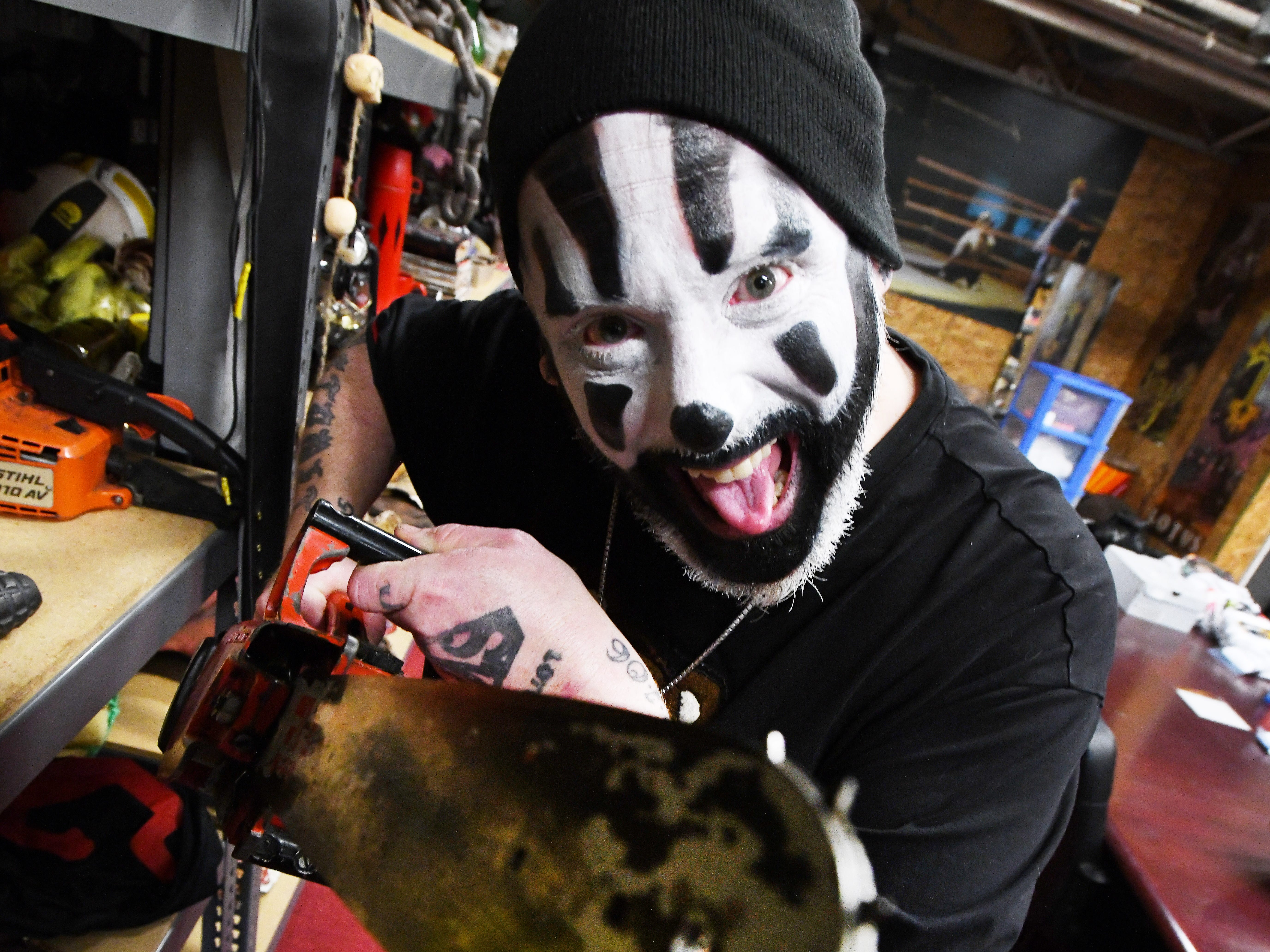 Violent J, aka Joseph Bruce of Insane Clown Posse, shows off costume storage where outfits and various paraphernalia, including a chainsaw prop, are stored from their elaborate shows and tours.