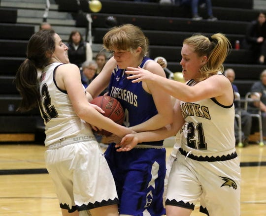 Jillian Casey, center, of Horseheads battles for possession with Corning's Lauren Beall (12) and Erin Terwilliger (21) on Wednesday at Corning-Painted Post High School.
