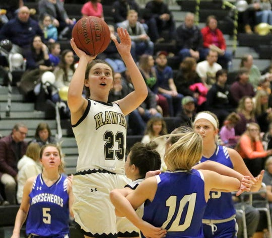Emma Webster of Corning puts up a shot against Horseheads on Wednesday at Corning-Painted Post High School.