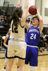 Jillian Casey of Horseheads puts up a shot as Lauren Beall of Corning defends on Wednesday at Corning-Painted Post High School.