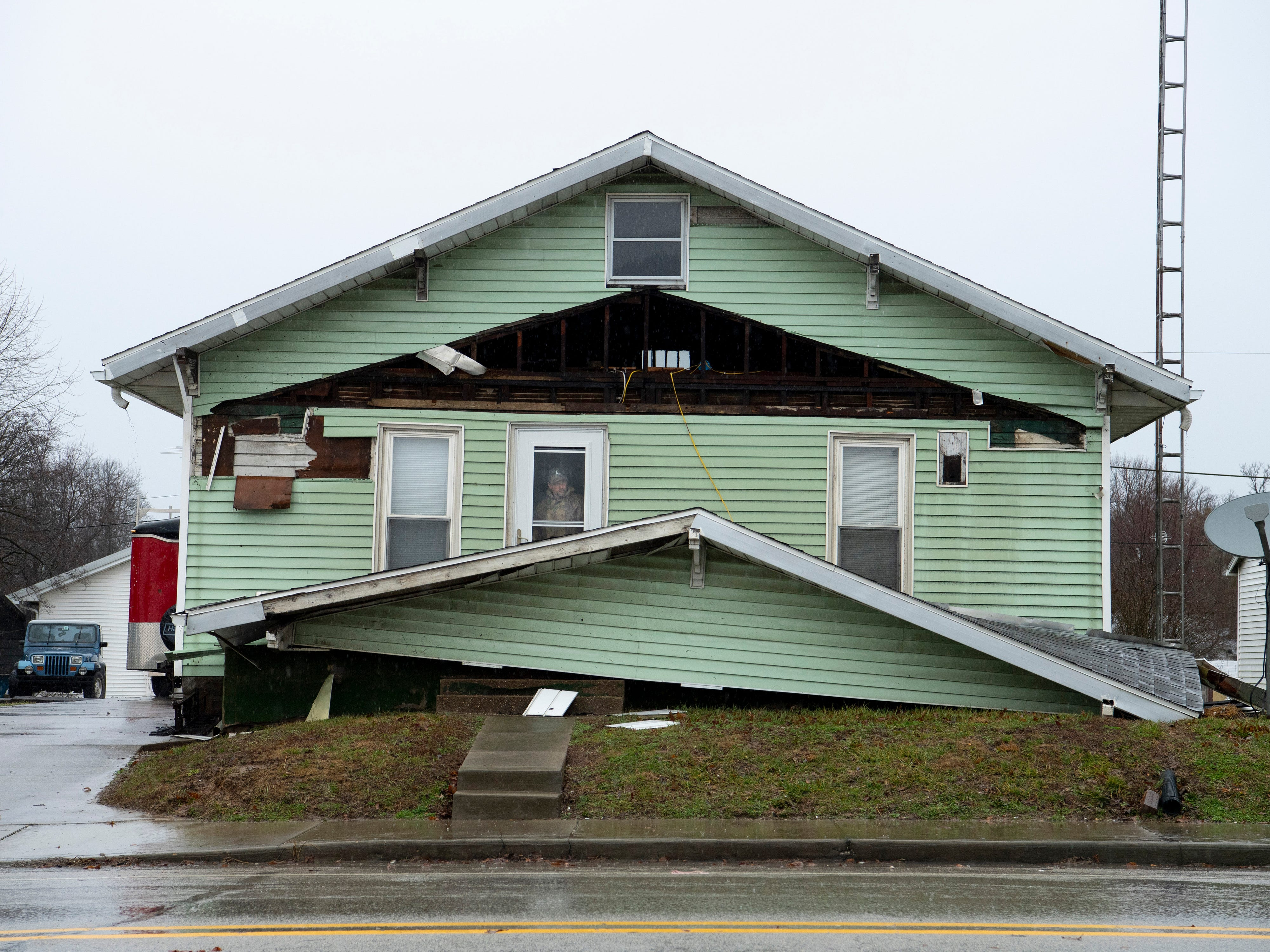 A storm knocked removed the front porch's roof from this Oakland City home Thursday morning.