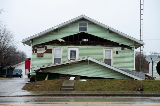 A storm removed the front porch's roof from this Oakland City home Thursday morning.
