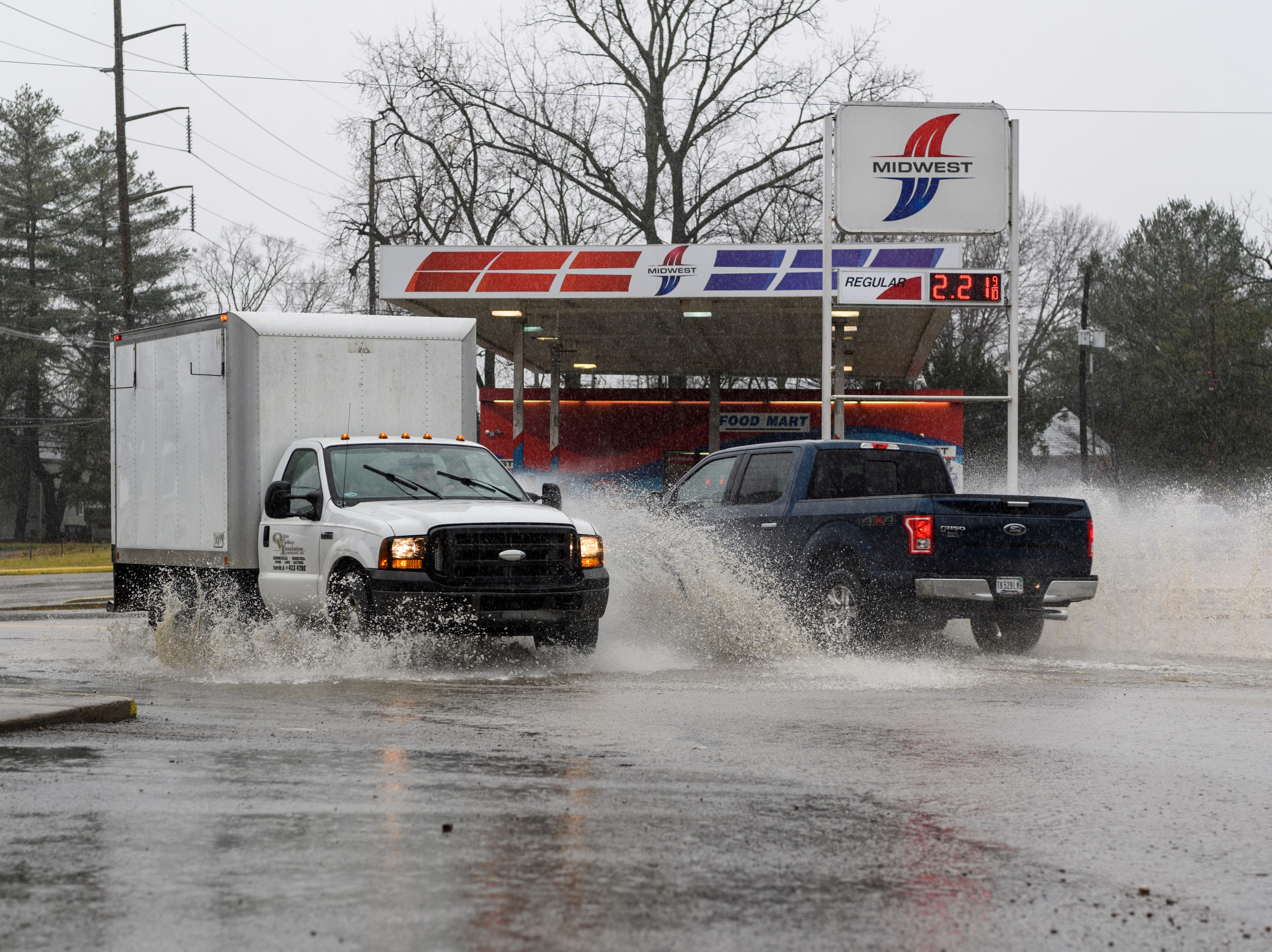 Vehicles drive through standing water at the intersection of North Tekoppel Avenue and Upper Mount Vernon Road on Evansville's west side as heavy rain hit the area, Thursday morning, Feb. 7, 2019.