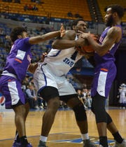 Evanville's Shamar Givance and John Hall close in on Indiana State's Emondre Rickman and force him to lose the ball in the second half of the Purple Aces' 85-62 loss on Wednesday in Terre Haute.