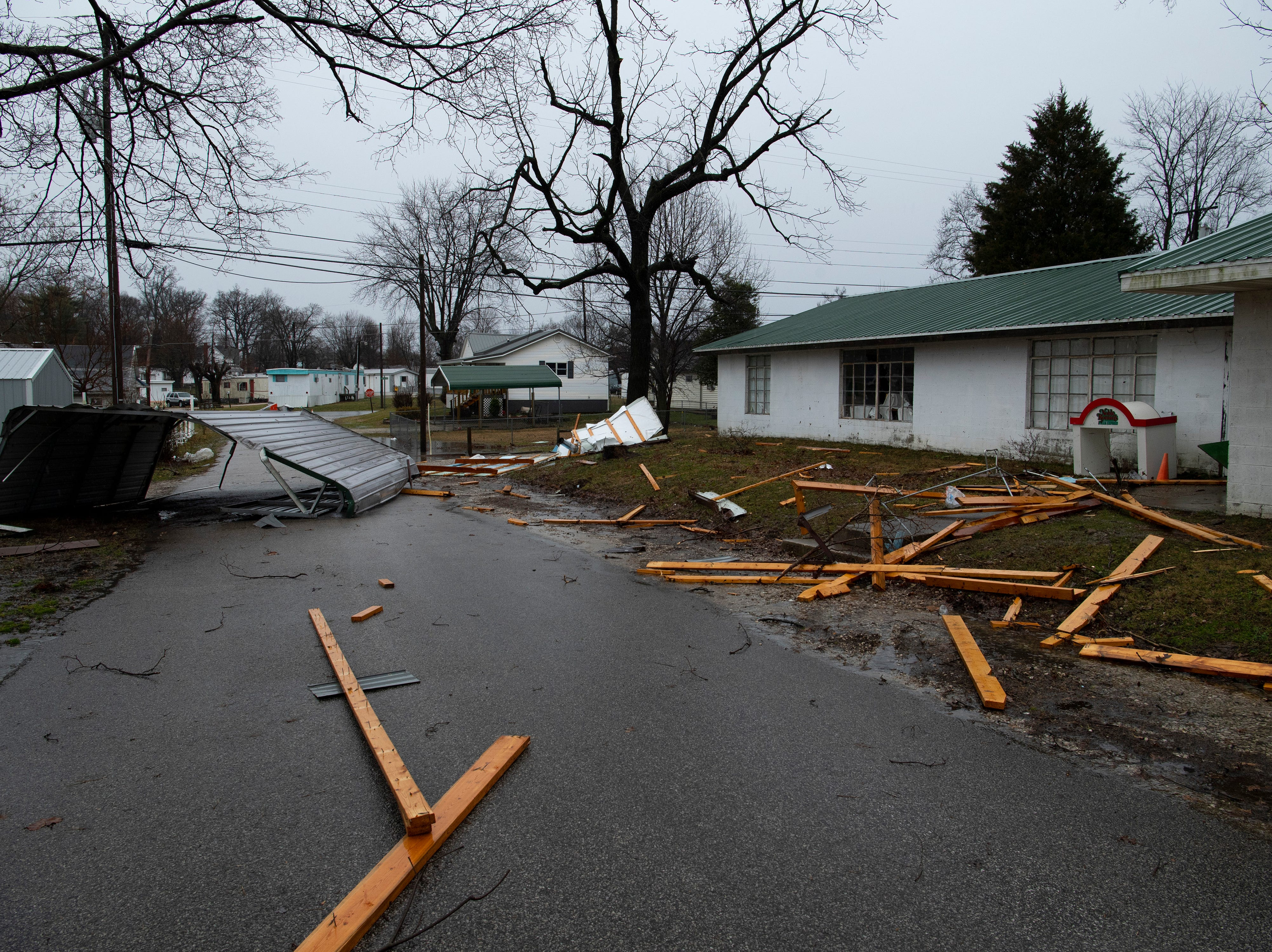Wooden studs a strewn across a neighborhood street in Oakland City, Ind., after a storm hit the Gibson County town Thursday morning.