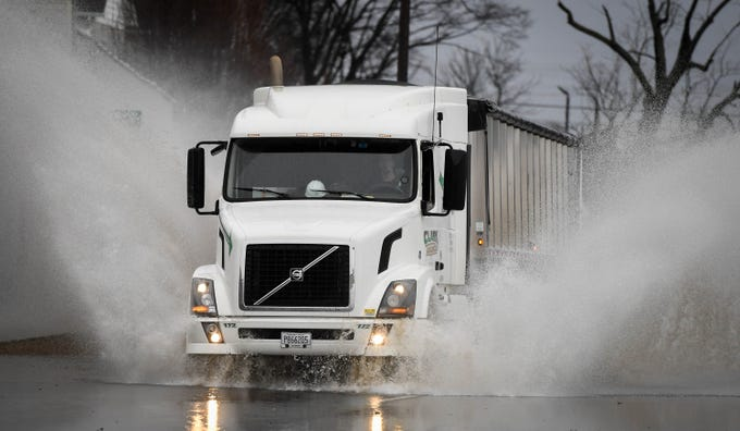 A semi-truck drives through standing water on North Green Street in Henderson following a mid-day downpour Thursday, February 7, 2019.