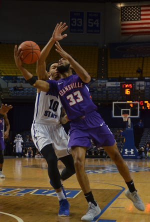 Evansville's K.J. Riley drives against Indiana State's Christian Williams in the first half of the Purple Aces' loss on Wednesday in Terre Haute.