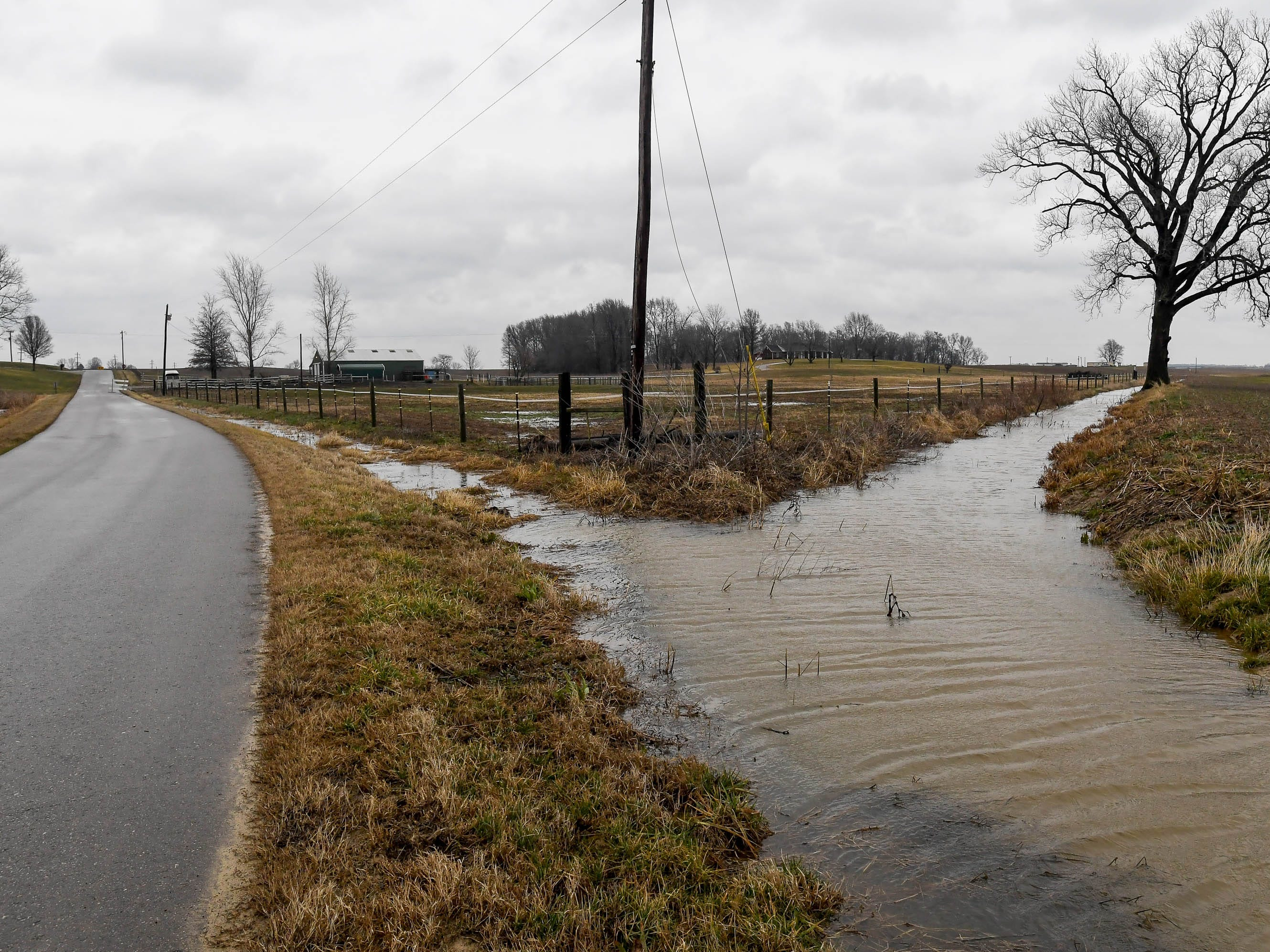 High water and soggy fields surround Toy Anthoston Road in Henderson County Thursday, February 7, 2019.