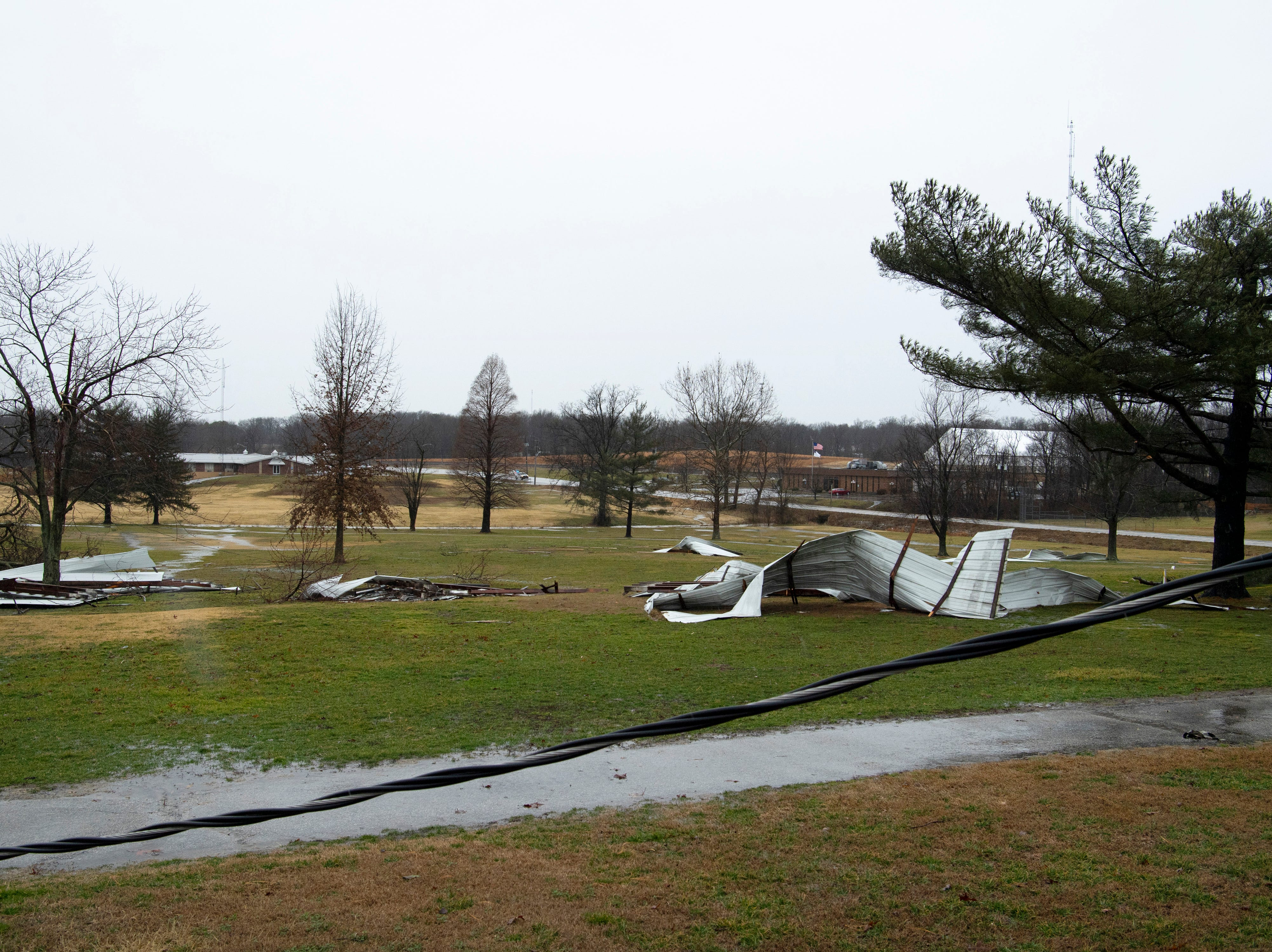 The Oakland City Golf Club is strewn with corrugated metal building panels after a storm hit the Gibson County town Thursday morning.