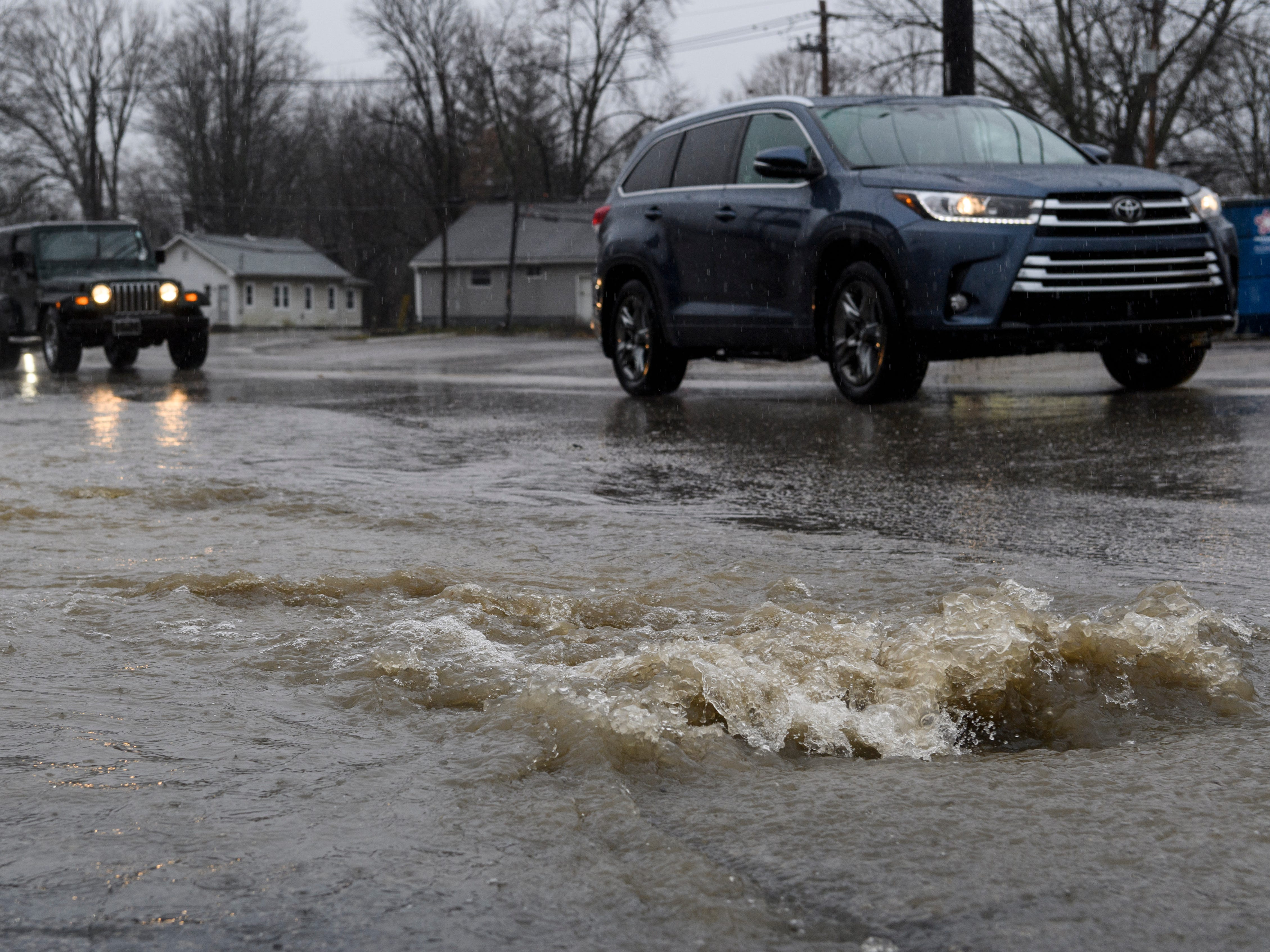 Heavy rain causes standing water to flood the roads near the intersection of North Tekoppel Avenue and Upper Mount Vernon Road on Evansville's west side, Thursday, Feb. 7, 2019.