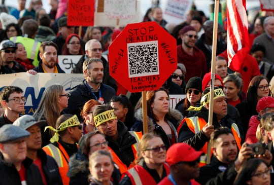 FILE - In this Jan. 30, 2019, file photo, Denver Public Schools teachers rally outside the State Capitol in Denver. Teachers plan to strike next week after Colorado officials declined to intervene in a pay dispute between the educators and the school district. State officials said Wednesday, Feb. 6, 2019, they believe the two sides are close to a negotiated agreement. Gov. Jared Polis said he expects the Denver Public Schools system and the union representing teachers to keep talking through the week to try to avoid a strike. (AP Photo/David Zalubowski, File)