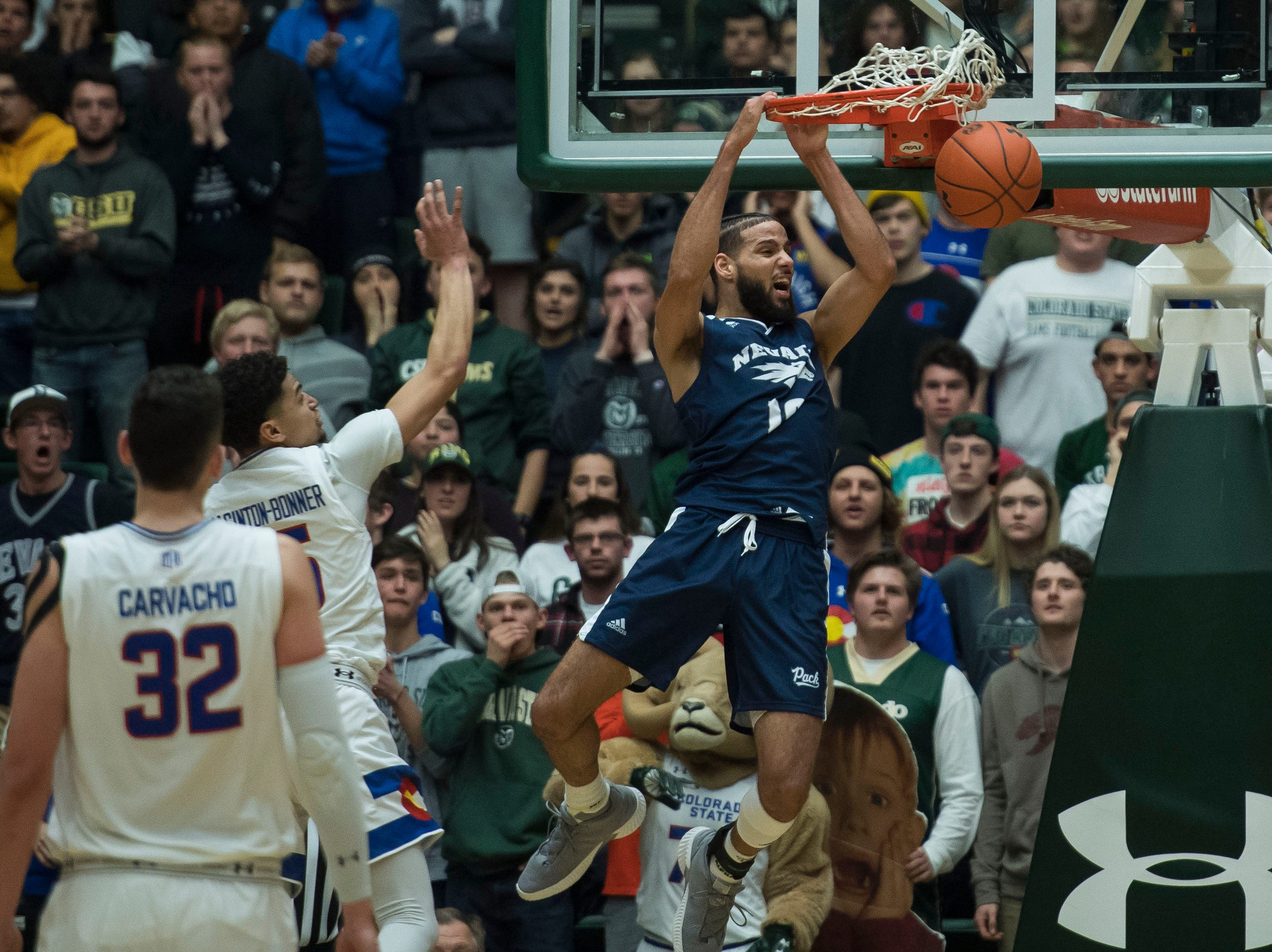 Nevada senior guard Caleb Martin (10) dunks during a game against the Colorado State University on Wednesday, Feb. 6, 2019, at Moby Arena Fort Collins, Colo.