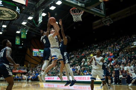 CSU's Adam Thistlewood gets a shot past Nevada defenders Tre'Shawn Thurman and Jazz Johnson during a Feb. 6 game at Moby Arena. The Rams are at home again Tuesday for a 9 p.m. game against San Diego State.