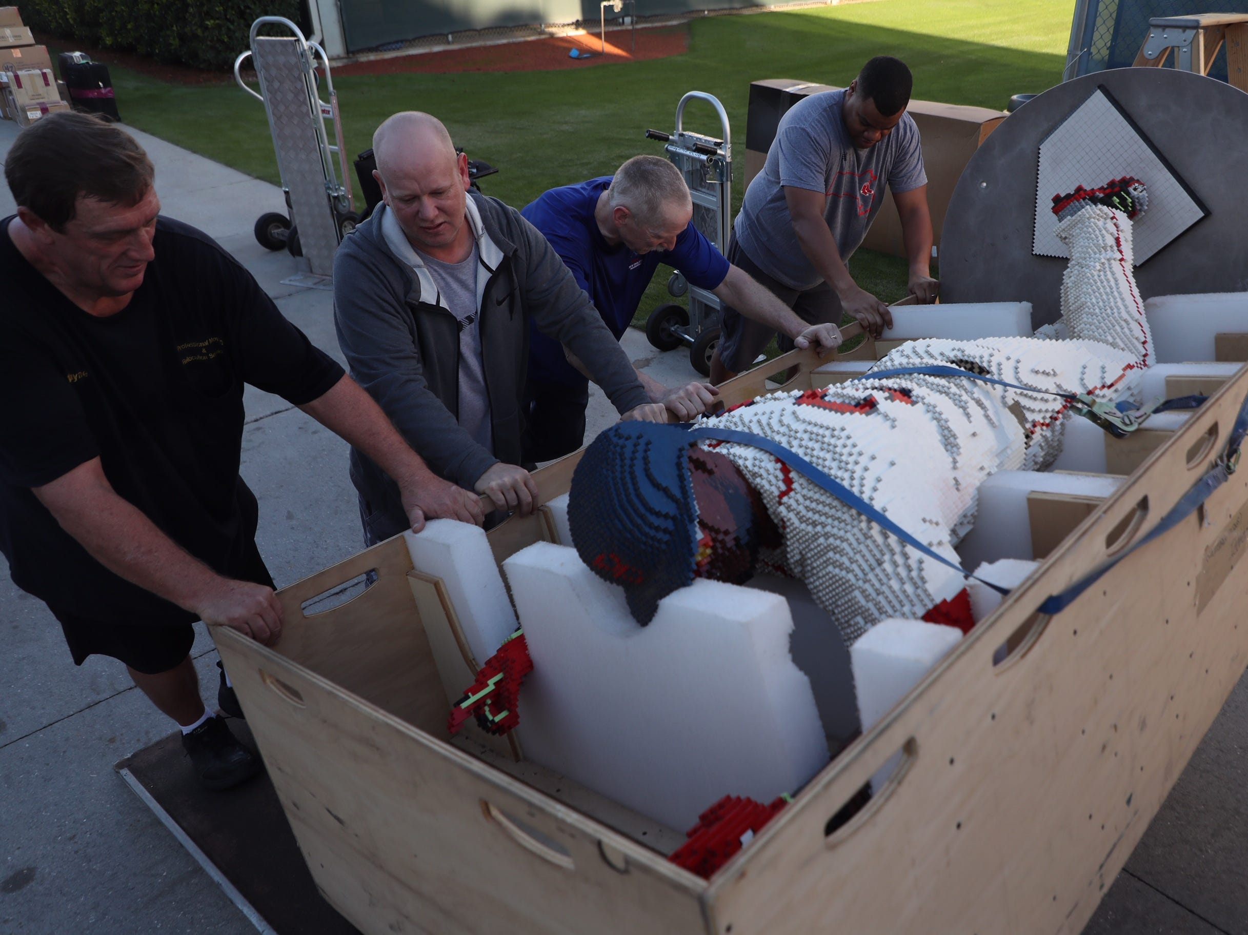 A LEGO sculpture of Red Sox legend David Ortiz is unloaded from the Red Sox equipment truck.