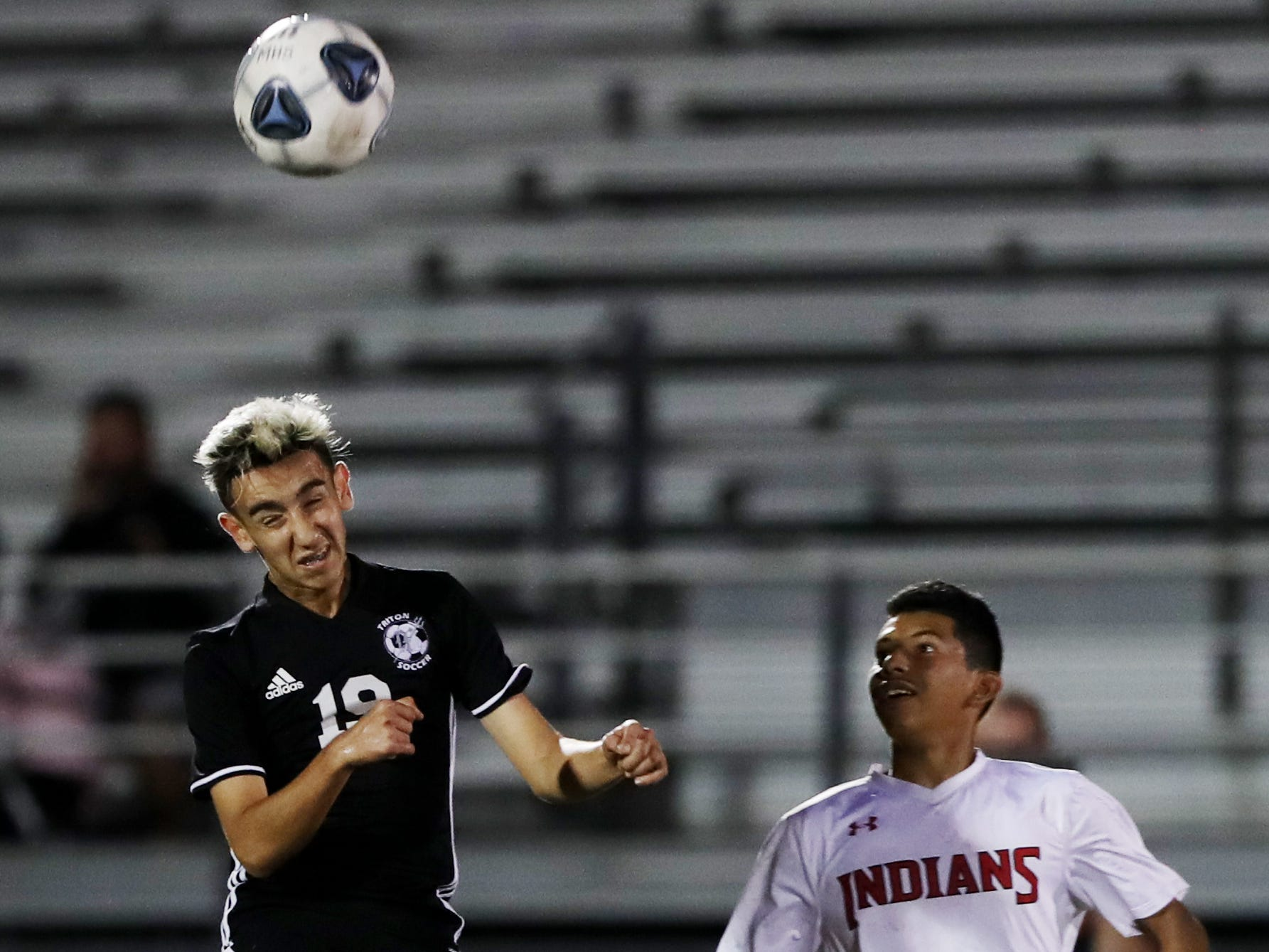 Mariner High School's Jason Arias fields a pass against Immokalee on Wednesday in the Class 3A regional quarterfinal. Mariner beat Immokalee 2-0.