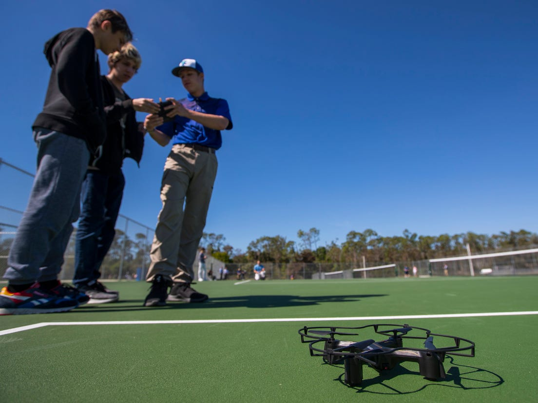 From left, Owen Milove, Samuel Swartzman and Luke Hepokoski, practice their in drone-piloting skills as part of their Bonita Springs High School curriculum Thursday, February 7, 2019. The school has an Aerospace Academy offering a four-year program that teaches students the basics about aviation and gives them a chance to get theirÊprivate pilot's license.