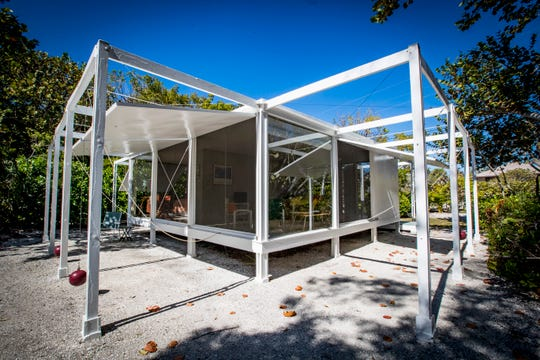 """The guest home is nicknamed the """"spider"""" because of the beams that were built off the home to hold the weights for the shutters. The Walker guest home and main home on Sanibel. The Walker guest house was designed by architect Paul Rudolph. The Cottage is considered the pedigree of mid-century modernism and was recognized by AIA Florida Chapter's Best Residential Building in the State of Florida. Also known as the """"Cannonball House"""" and """"Spider"""" because of the red cannonballs Rudolph used as weights to  hold the signature wood shutters in place."""