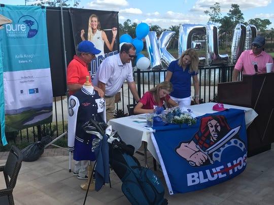 Estero High School senior Kelli Kragh signed to play at Presbyterian alongside her parents Tim and Liz and her swing coach Bobby Clampett on Thursday after an outstanding career as a Wildcat.