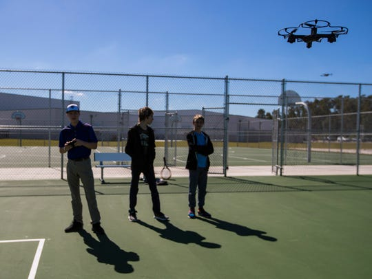 From left, Luke Hepokoski, Samuel Swartzman and Owen Milove, practice their drone-piloting skills as part of their Bonita Springs High School curriculum Thursday, February 7, 2019. The school has an Aerospace Academy offering a four-year program that teaches students the basics about aviation and gives them a chance to get theirÊprivate pilot's license.
