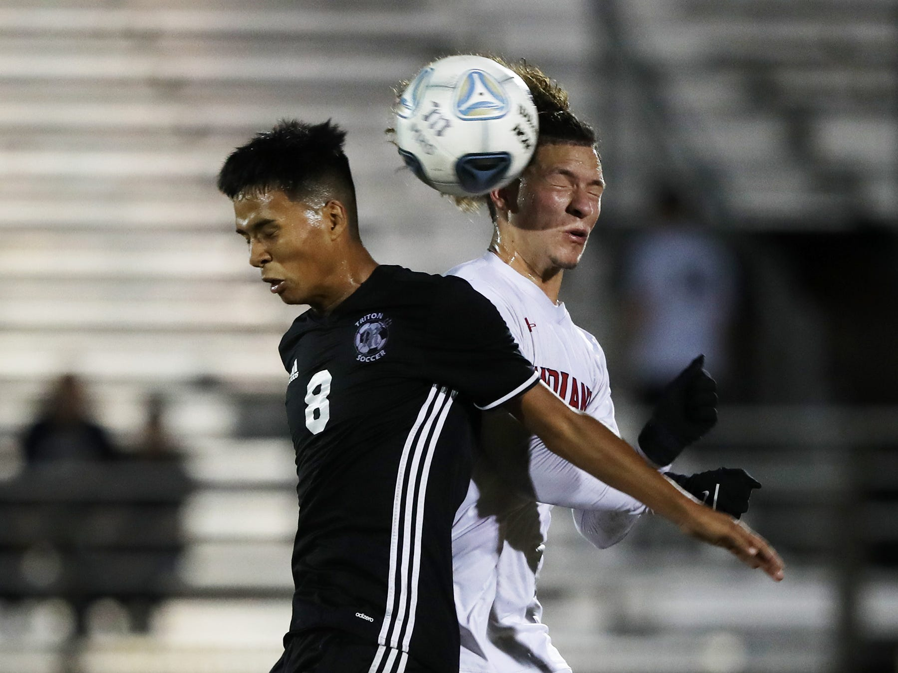 Mariner High School's Alex Franco, left, battles Immokalee's Guadalupe Guzman on Wednesday in the Class 3A regional quarterfinal. Mariner beat Immokalee 2-0.