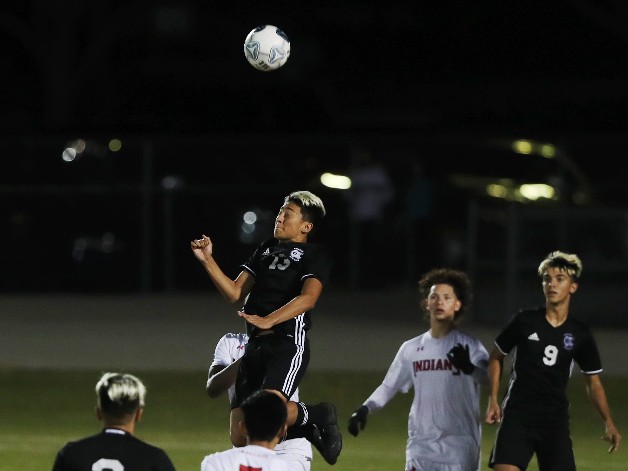 Mariner High School's Esteban Orjuela fields a pass against Immokalee on Wednesday in the Class 3A regional quarterfinal. Mariner beat Immokalee 2-0.