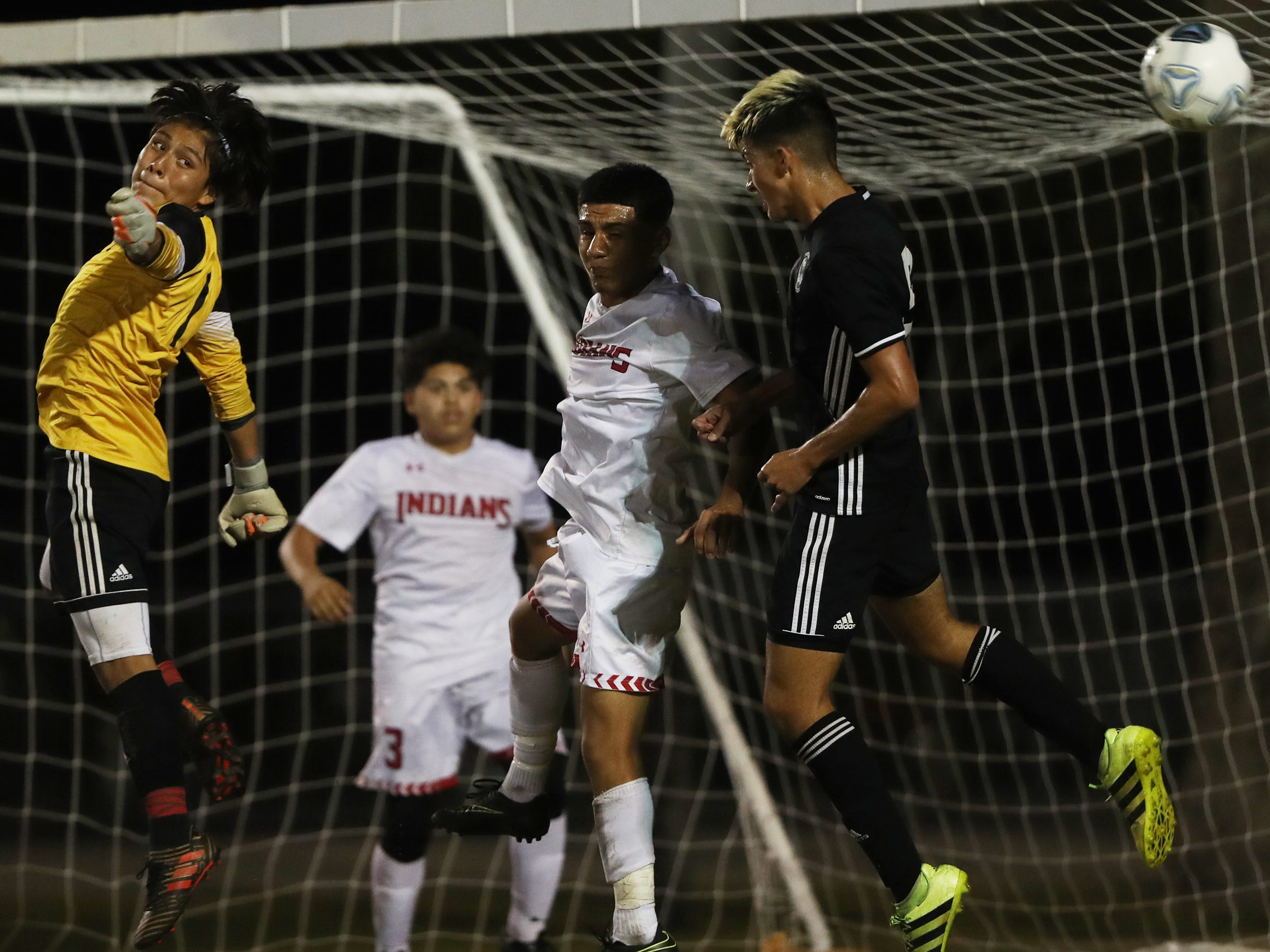 Immokalee High School's Alexander Gaspar, left, blocks a shot against Mariner on Wednesday in the Class 3A regional quarterfinal. Mariner beat Immokalee 2-0.