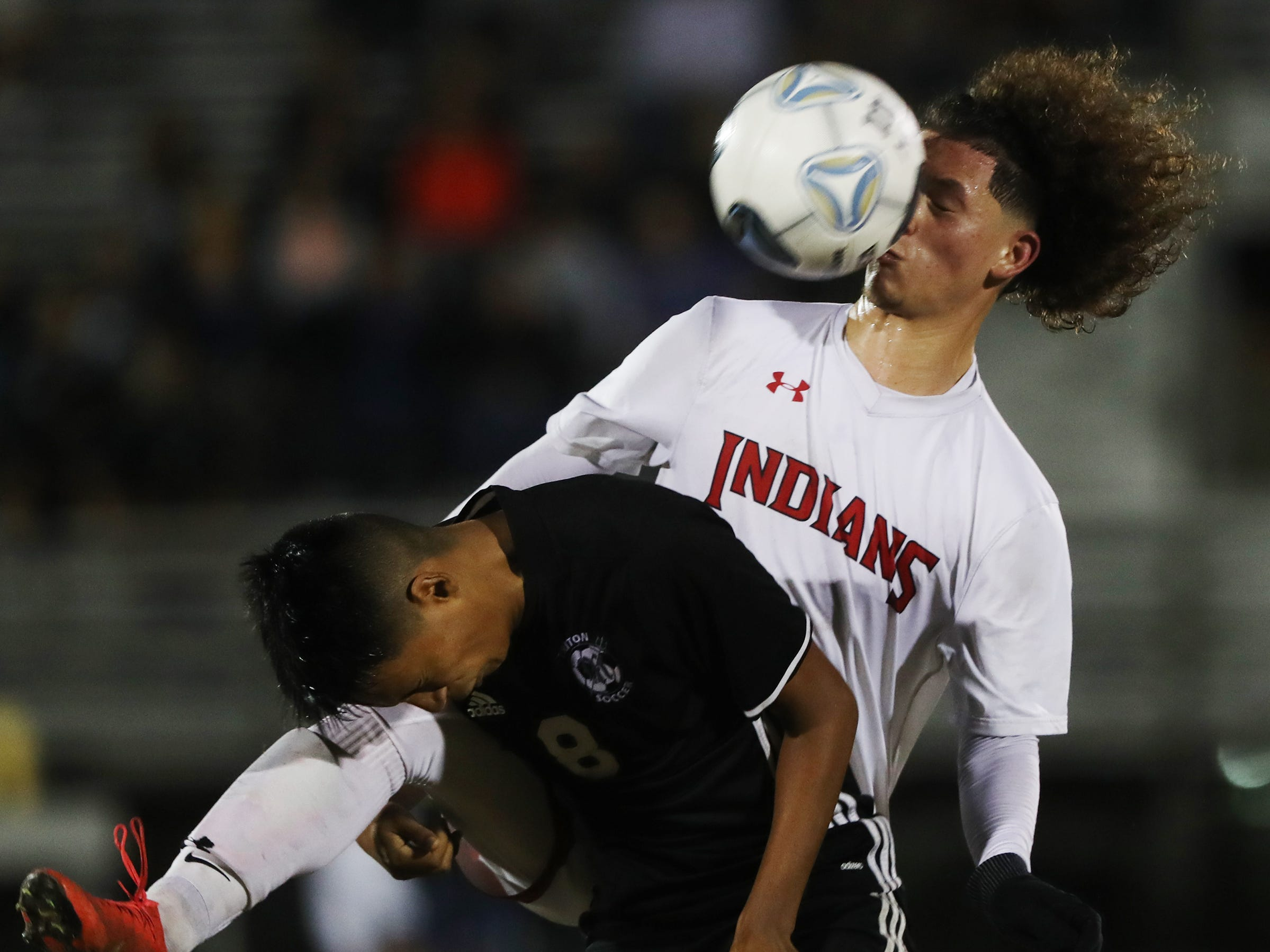 Mariner High School's Alex Franco, left, battles Immokalee's Guadalupe Guzman on Wednesday in the Class 3A regional quarterfinal. Mariner Immokalee Cape 2-0.