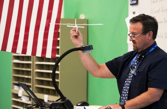 Todd Callahan, Bonita High School's aerospace teacher, uses a model airplane to demonstrate some of the characteristics of flying a plane Thursday, February 7, 2019. The school has an Aerospace Academy offering a four-year program that teaches students the basics about aviation and gives them a chance to get theirÊprivate pilot's license.