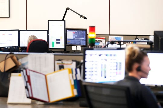 Dispatchers work at the Brown County Public Safety Communications office on Thursday in Green Bay.