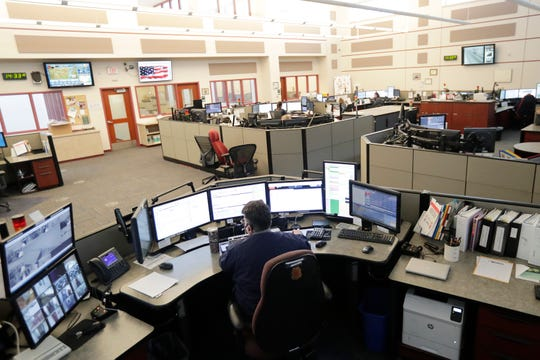 Dispatchers work at the Brown County Public Safety Communications office on Thursda in Green Bay.
