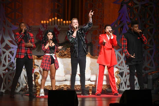 Matt Sallee, from left, Kirstin Maldonado, Scott Hoying, Mitch Grassi, and Kevin Olusola of Pentatonix perform in December in New York City.