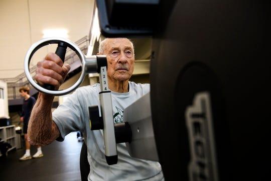 Jack Overpeck uses an arm bike machine at Furman University on Wednesday, Feb. 6, 2019.