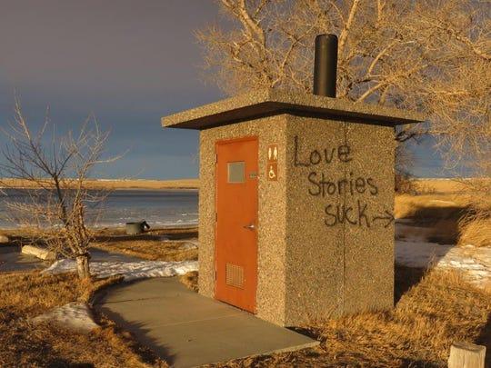 A vandalized latrine at Eureka Reservoir.
