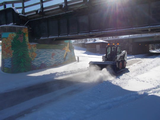 River's Edge Trail is swept of snow Thursday. Another 1 to 2 inches is possible Friday evening into Saturday morning.