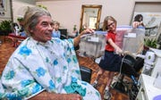 Shepherd DeBenedictis, left, and his daughter, Raylene DeBenedictis, 12, compare their the lengths of locks cut from their hair at the Grace Beauty Shop in Tamuning on Wednesday, Feb. 6, 2019. The father-daughter duo plan to donate their locks to 360 Hair Inc. and Wigs for Kids, respectively, to be fabricated into wigs for people suffering from medical hair loss.