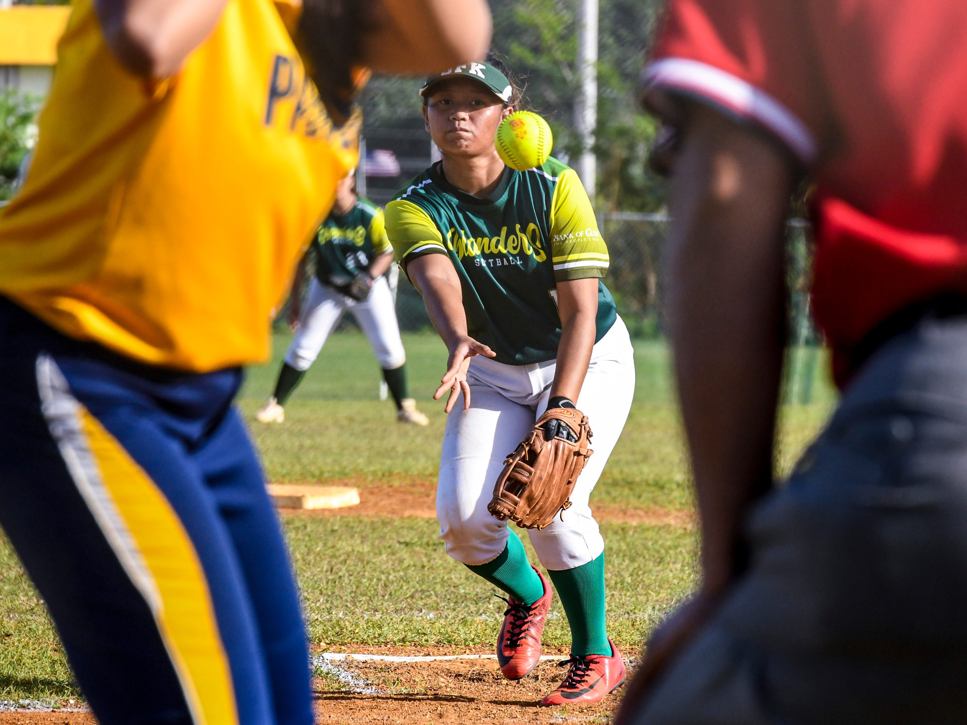 The John F. Kennedy Islanders' pitcher, Emani Gutierrez, lets loose a pitcher to a Guam High Panther batter during their IIAAG girls softball matchup at the JFK High School campus in Tamuning on Thursday, Feb. 7, 2019.