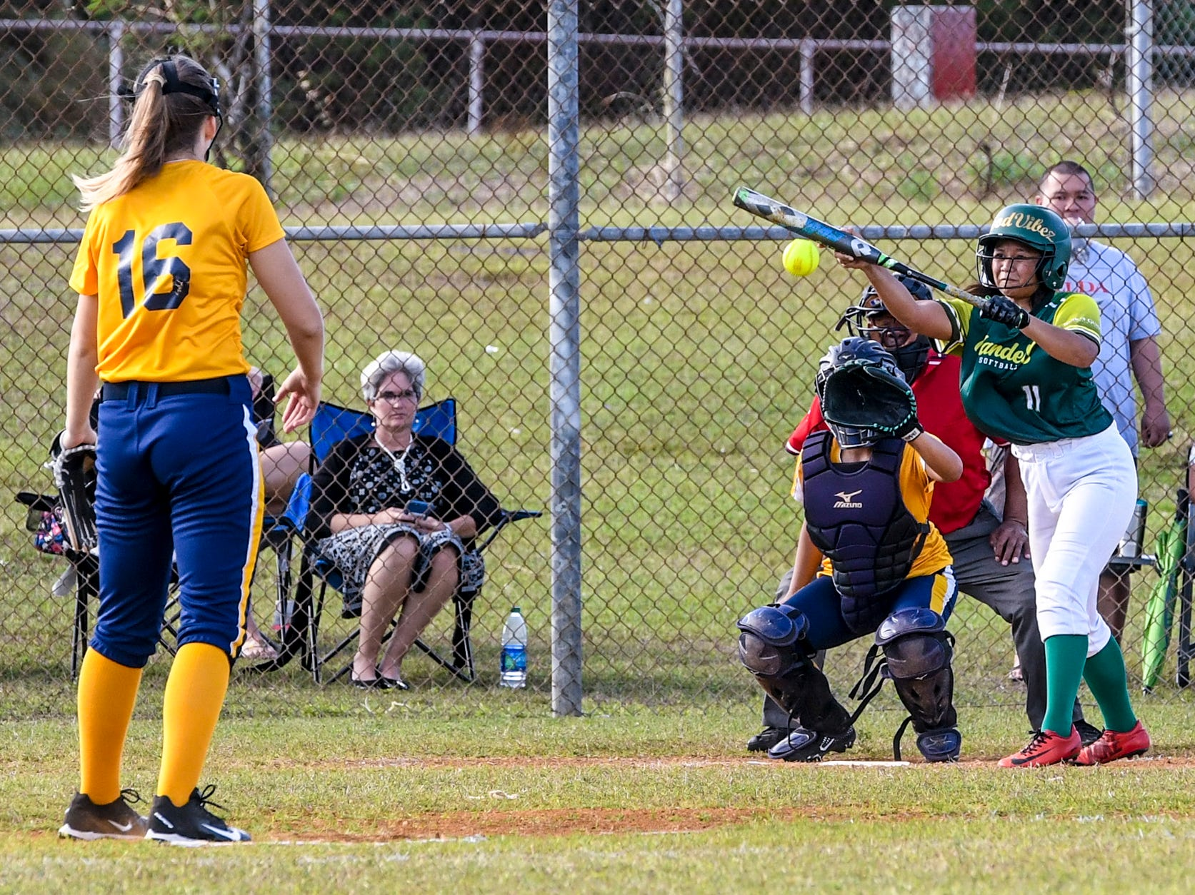 The John F. Kennedy Islanders' pitcher, Emani Gutierrez, opts to bunt a pitch during an IIAAG Girls Softball matchup with the Guam High Panthers at the JFK High School campus in Tamuning on Thursday, Feb. 7, 2019. Unfortunately, Gutierrez was unable to beat the throw to first for a base hit.