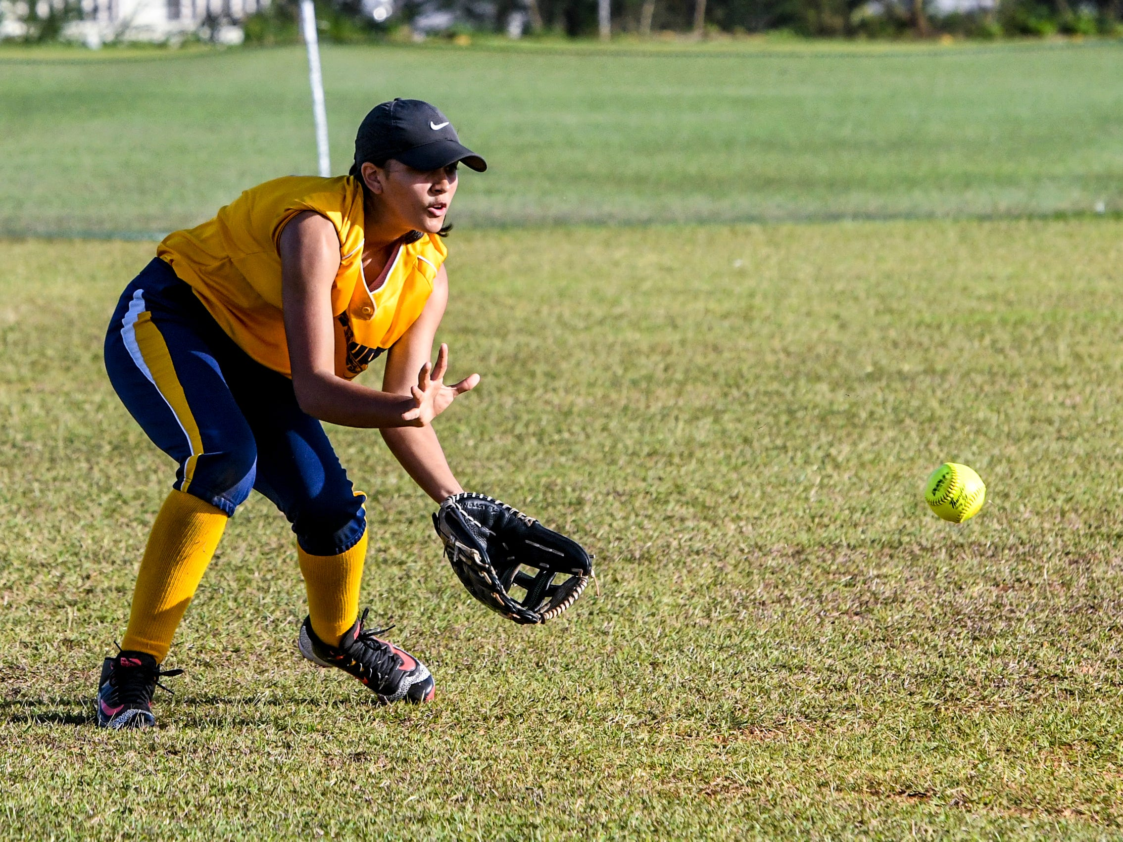 Guam High Panthers' Gabriella Rodriguez fields a ground hopper during an IIAAG girls softball matchup with the John F. Kennedy Islanders at the JFK High School campus in Tamuning on Thursday, Feb. 7, 2019.