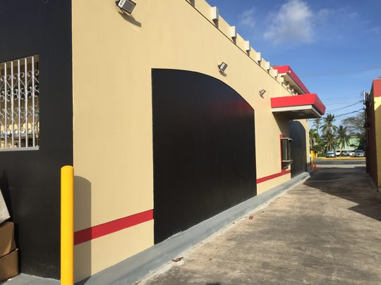 Black panels are seen on both sides of the drive-thru window at Hagåtña Domino's. Huhne plans to have local artists paint on the panels, as artist Austin Domingo had done for the chalkboard aesthetic of Tamuning Domino's.